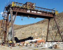 Motor-driven cable reel, cable festoon, and TrenchGuard systems power a large gantry crane.