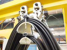 I-beam cable festoon system in use on a Pouring Crane