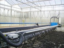 A Cable Festoon System is used for the Energy Transmission to a solar sludge drying mobile system